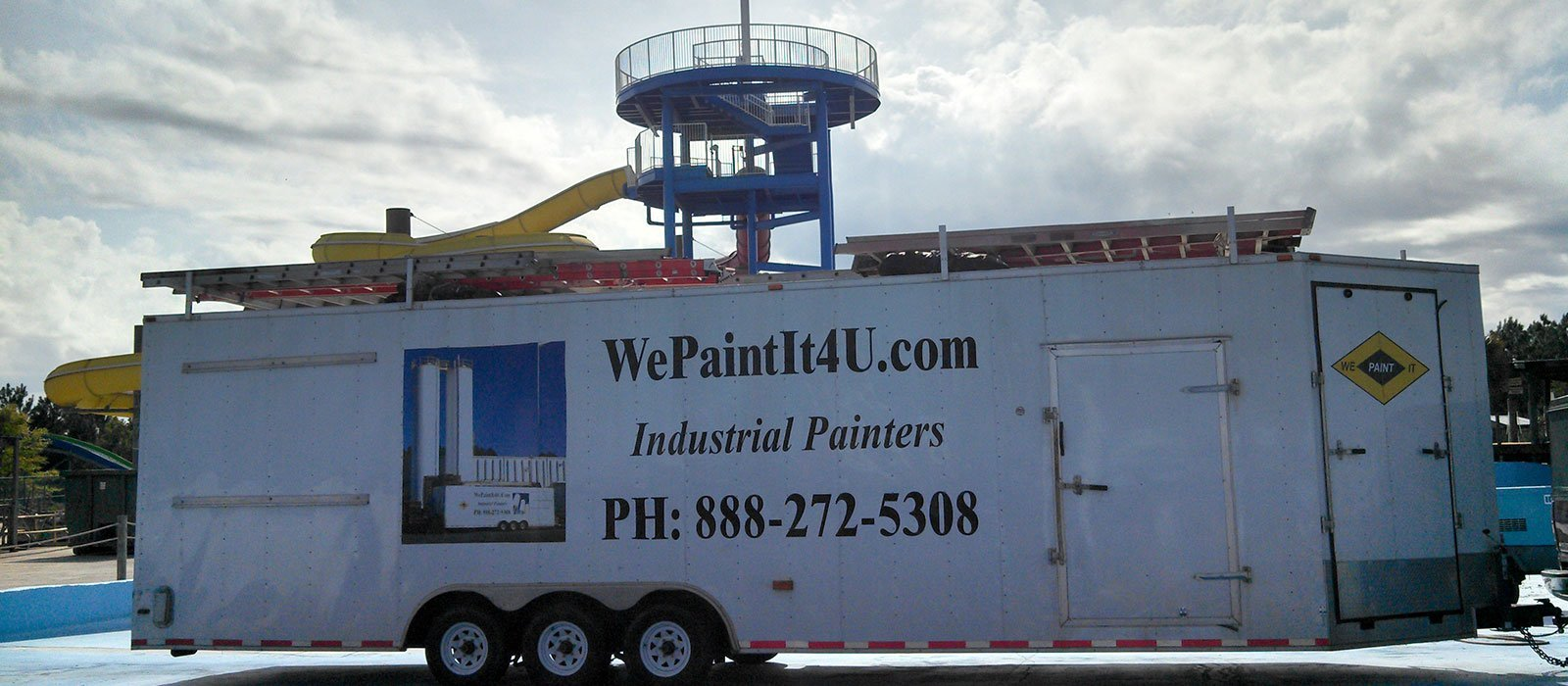 trailer in front of painted slide at water park