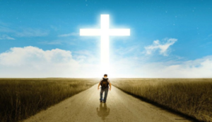 Man walking toward the cross